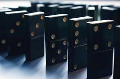 Muitos do suporte preto dos dominós Imagem de Stock