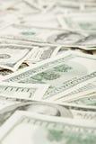 Muitos E.U. 100 dólares, fundo do negócio Foto de Stock Royalty Free