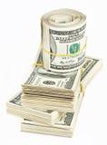 Muitos empacotam e rolo dos E.U. 100 dólares de notas de banco Imagens de Stock