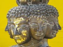 Muitos enfrentam a estátua em Banguecoque Fotografia de Stock Royalty Free