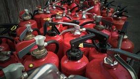 Muitos extintores usados como o fundo Imagem de Stock