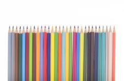 Muitos lápis coloridos em seguido Imagem de Stock