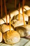 Muitos pães com velas Fotos de Stock Royalty Free