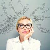Muitos pensamentos com mulher de negócio Imagem de Stock Royalty Free