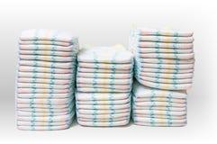 Muitos tecidos empilhados no fundo branco Foto de Stock Royalty Free