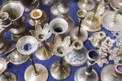 Muitos vela-suportes de prata velhos Fotografia de Stock Royalty Free