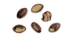 Muizen gebeten chocoladesuikergoed op isolate Stock Foto's
