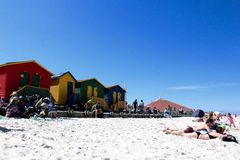 Muizenberg Beach. The colourful houses and beach going people on a sunny day at Muizenberg Beach, Cape Town, South Africa Royalty Free Stock Photography