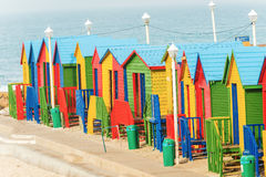 Muizenberg Beach Huts South Africa. Colorful beach huts in a row on the white sandy Beach of Muizenberg under a blue summer sky. Muizenberg, Cape Town, South Royalty Free Stock Photography