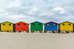 Muizenberg, Cape Town, South Africa. The colourful beach houses on Muizenberg beach - a popular tourist attraction near Cape Town, South Africa Royalty Free Stock Photos
