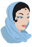 Mujer árabe en una bufanda azul. Imagen de archivo libre de regalías