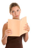 Mujer aburrida con el libro Foto de archivo libre de regalías