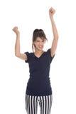 Mujer acertada joven feliz que anima con las manos para arriba. Foto de archivo