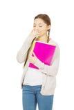 Mujer adolescente aburrida con el cuaderno Fotografía de archivo libre de regalías