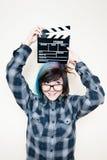Mujer adolescente alternativa bastante joven con la chapaleta de la película Imagen de archivo