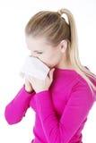 Mujer adolescente con alergia Imagen de archivo libre de regalías