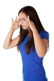 Mujer adolescente con dolor de cabeza Imagen de archivo