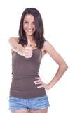 Mujer adolescente con el pulgar para arriba Imágenes de archivo libres de regalías