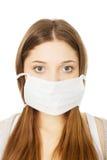 Mujer adolescente con la máscara protectora Fotografía de archivo