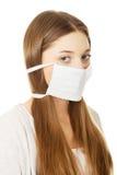 Mujer adolescente con la máscara protectora Fotos de archivo libres de regalías