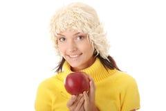 Mujer adolescente con la manzana roja Fotografía de archivo