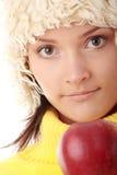 Mujer adolescente con la manzana roja Foto de archivo libre de regalías
