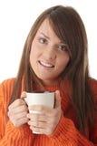 Mujer adolescente con la taza de café Foto de archivo libre de regalías