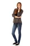 Mujer adolescente con las manos dobladas Imagen de archivo