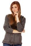 Mujer adolescente con las manos dobladas Imagen de archivo libre de regalías