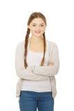 Mujer adolescente con los brazos cruzados Imagen de archivo libre de regalías