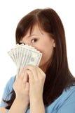 Mujer adolescente con los dólares. Fotografía de archivo libre de regalías