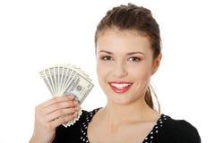 Mujer adolescente con los dólares. Imagenes de archivo
