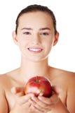 Mujer adolescente del ajuste feliz con la manzana Imagen de archivo