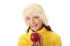 Mujer adolescente del otoño con la manzana roja Imágenes de archivo libres de regalías