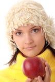 Mujer adolescente del otoño con la manzana roja Fotografía de archivo libre de regalías