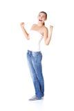 Mujer adolescente emocionada con los puños para arriba Imagen de archivo libre de regalías