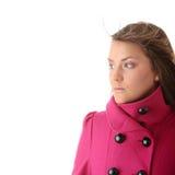 Mujer adolescente en capa femenina rosada Imagen de archivo libre de regalías