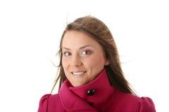 Mujer adolescente en capa femenina rosada Imagen de archivo
