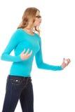 Mujer adolescente enojada que hace los puños Imagen de archivo