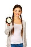 Mujer adolescente feliz con el despertador Imagenes de archivo