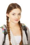Mujer adolescente feliz con la mochila Foto de archivo libre de regalías