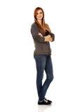 Mujer adolescente feliz con los brazos doblados Imágenes de archivo libres de regalías