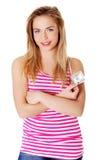 Mujer adolescente joven con los dólares. Fotografía de archivo libre de regalías