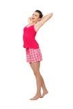 Mujer adolescente joven en pijamas rosados Fotografía de archivo libre de regalías