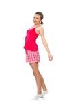 Mujer adolescente joven en pijamas rosados Fotografía de archivo