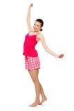 Mujer adolescente joven en pijamas rosados Imagenes de archivo