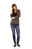 Mujer adolescente preocupante con los brazos doblados Fotografía de archivo libre de regalías