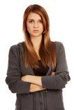 Mujer adolescente preocupante con los brazos doblados Imágenes de archivo libres de regalías