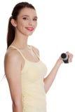 Mujer adolescente que hace ejercicio de la aptitud Imagen de archivo libre de regalías