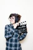 Mujer adolescente sonriente con el tablero de chapaleta Fotografía de archivo libre de regalías